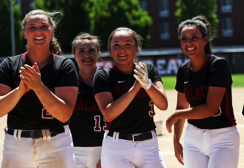 TIMES PHOTO: DAN BROOD - Tualatin's, from left, Emily Johansen, Andrea Gomez, Taylor Alton and Zoe Olivera were all smiles during the victory celebration.