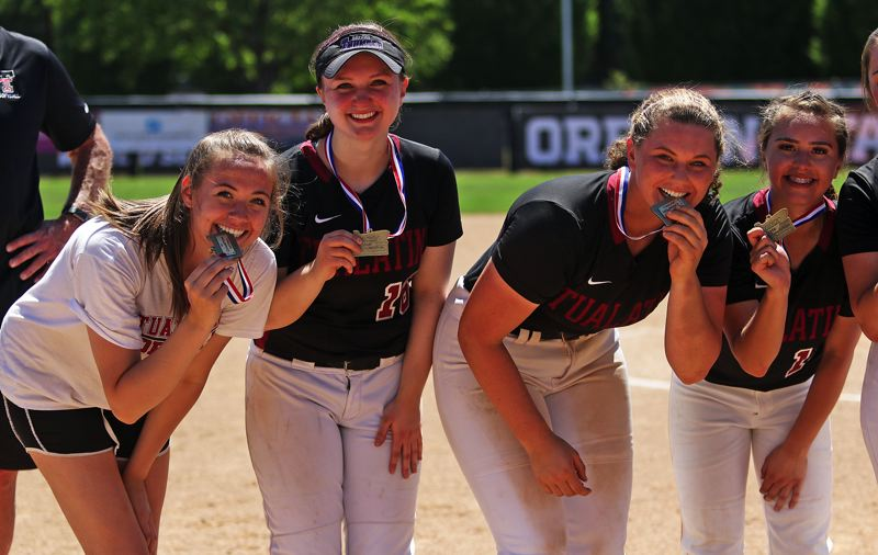 TIMES PHOTO: DAN BROOD - Tualatin's (from left) Elizabeth Hillier, Megan Woodward, Emily Johansen and Andrea Gomez show off their state championship medals.
