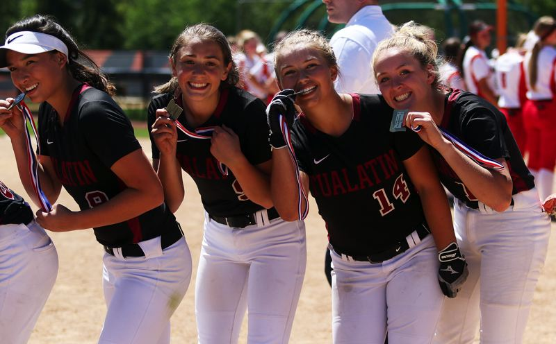 TIMES PHOTO: DAN BROOD - Tualatin's (from left) Lily Marshall, Sydney Wagner, Taylor Corcoran and Ella Hillier show off their state championship medals.