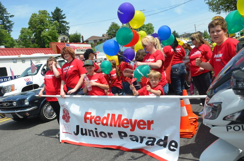 COURTESY PHOTO: ROSE FESTIVAL - Balloons and banners led the way for Wednesday's Fred Meyer Junior Parade.