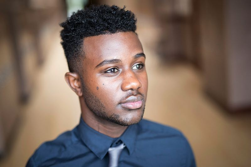 TRIBUNE PHOTO: JAIME VALDEZ - Abel Getachew will graduate June 9 from De La Salle North Catholic High School. Originally from Ethiopia, Getachew has worked hard to support other immigrant students.