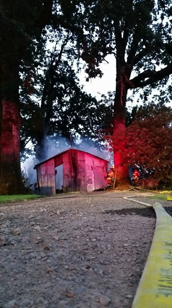 COURTESY PHOTO: BANKS FIRE DISTRICT - Smoke rises from an outbuilding at the Union Point Cemetery on Thursday morning.
