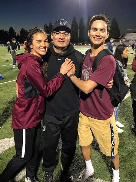 COURTESY PHOTO - Won (middle), Blake (right), and Jayda Lee (left) pose for a picture following a meet earlier this season.