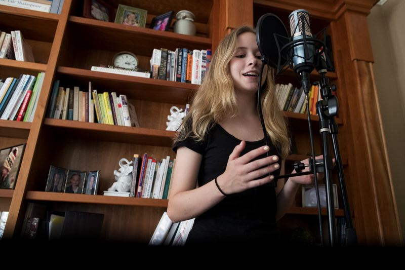 "TIMES PHOTO: JAIME VALDEZ - Tualatin High School sophomore Elise Popma sings the  song ""Before My Time has Come"" written by Ed Kopp, a music teacher from Silverton at her home in Tualatin."