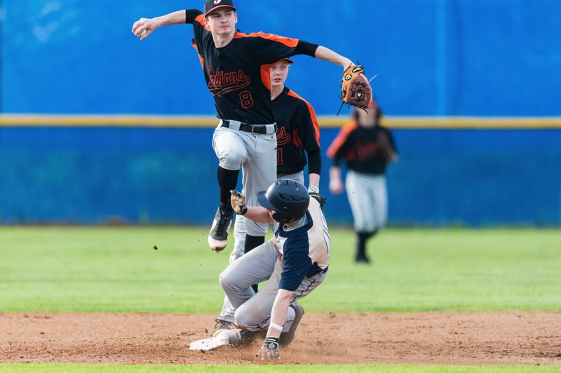 SPOTLIGHT FILE PHOTO - Scappoose senior J.C. Gross (shown here against Banks) is one of four Indians who won first-team all-Cowapa League honors this spring.