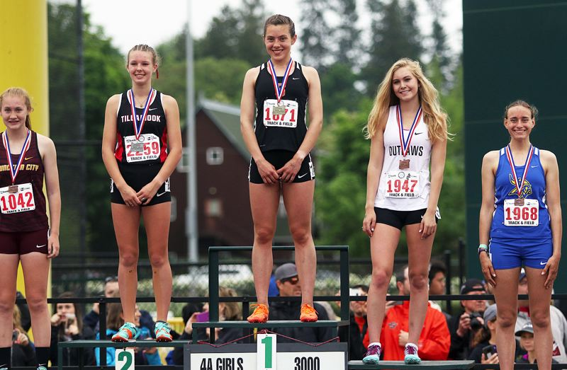 SPOTLIGHT FILE PHOTO - Scappoose senior Linnaea Kavulich (center) had plenty of reasons to smile at this year's Class 4A state track meet, among them her win in the girls 3,000 meters.