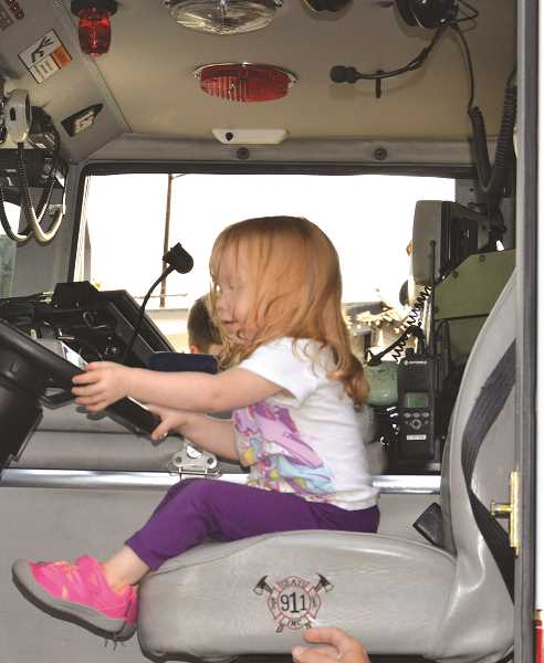 PIONEER PHOTO: CINDY FAMA - Kirsten gets in the driver's seat of a local fire rig.