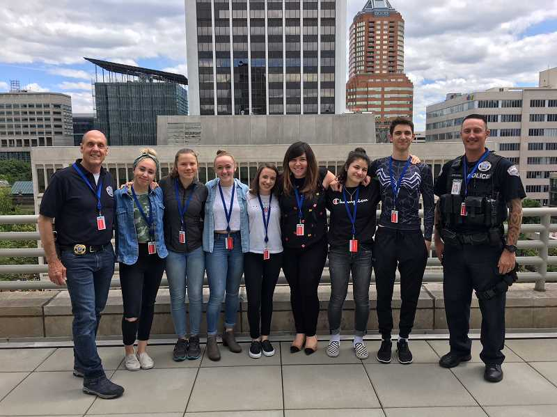 SUBMITTED PHOTO: DON JOHNSON - Lakeridge High students and Lake Oswego city officials traveled to Portland on June 1 to conduct Hands-Only CPR training. From left: Police Chief Don Johnson, Ella Guffey, Barbara Roehm, Emily Morton, Jessica Price, Parks & Rec Supervisor Jamie Inglis, Ayah Said-al-Naief, Declan Glover and Officer Bryan Sheldon.