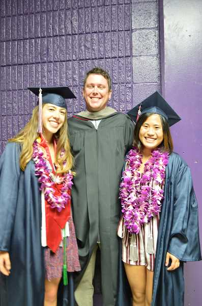 TIMES PHOTO: RAY PITZ - Alyssa Uhl, left, Ben Lyman and Nicole Nagasaka pose for a snapshot before ceremonies Thursday night. Both Uhl and Nagasaka, along with several other classmates were wearing leis, gifts from well-wishers.