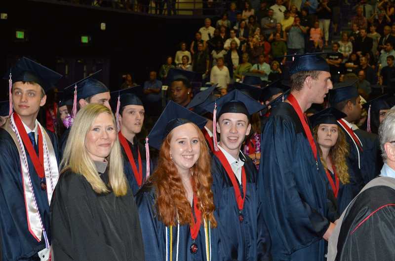 TIMES PHOTO: RAY PITZ - Seniors await graduation ceremonies Thursday night at the University of Portland's Chiles Center.
