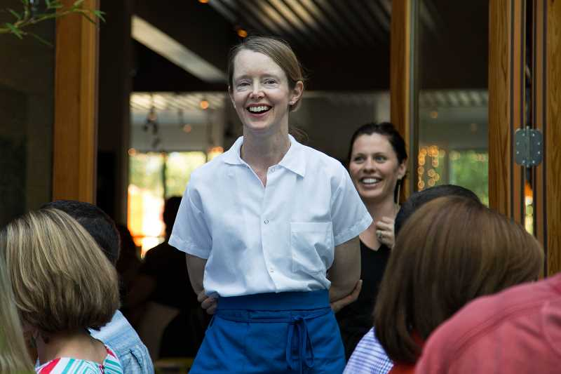 COURTESY PORTLAND FOOD ADVENTURES - Kelly Myers, chef at Xico, and Xico general manager Liz Davis (behind) hosted a Portland Food Adventures dinner a few years ago. A July 18 benefit dinner will support the Myers' recovery after an unexpected stroke.