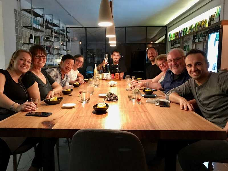 COURTESY PORTLAND FOOD ADVENTURES - A past Portland Food Adventures group enjoys a meal at a pop-up restaruant in Barcelona with Chef Jose Chesa (right) and PFA founder Chris Angelus (second from right). This year's fourth-annual Barcelona trip is set for Sept. 19-26, with seats available.