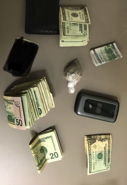 POLICE PHOTO - Police say they confiscated this money and drugs during a three-day sweep ahead of Portland's Fleet Week.