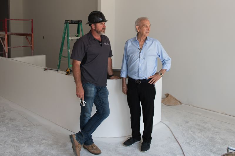 STAFF PHOTO: CHRISTOPHER OERTELL - General contractor Todd Richendollar (left) and developer Buzz Avery (right) stand inside the suite that will be the home of Pink Spoon, a frozen yogurt shop opening soon in Forest Grove.