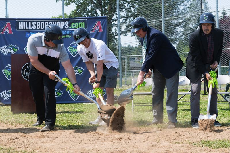 STAFF PHOTO: CHRISTOPHER OERTELL - Rian and Ben Petrick, along with Hillsboro Mayor Steve Callaway and former mayor Jerry Willey, joined in the groundbreaking ceremony to commemorate the Hillsboro Hops donation to build a new turf field.