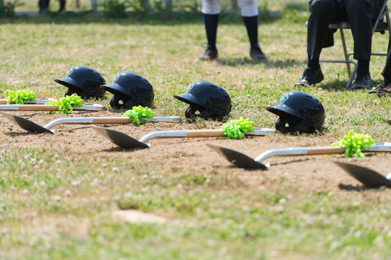 STAFF PHOTO: CHRISTOPHER OERTELL - Shovels and Hops batting helmets were laid out on the field for the groundbreaking ceremony.
