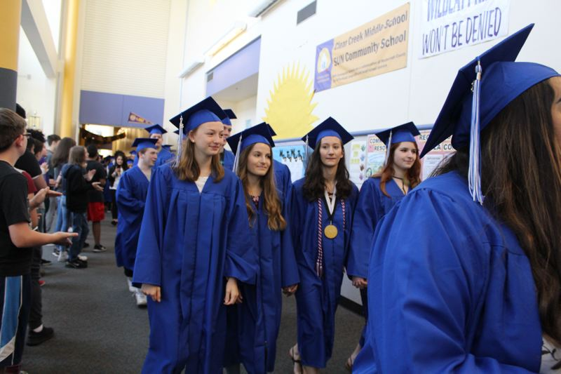 CONTRIBUTED PHOTO: GRESHAM-BARLOW SCHOOLS - Proud Gresham High School Gopher graduates parade through Clear Creek Middle School to cheers and high fives from the middle school students.