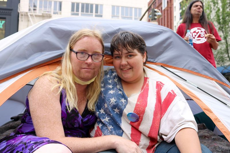 TRIBUNE PHOTO: ZANE SPARLING - FROM LEFT: Tina Drake and Chris Drake are sleeping in a tent on Southwest Washington Street on Friday, June 8 in downtown Portland.