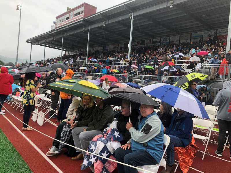 GAZETTE PHOTO: BLAIR STENVICK - Proud families and friends weren't deterred by rain at Sherwood High School's 2018 graduation ceremony.