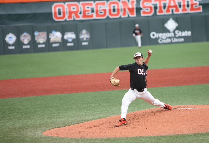 TRIBUNE PHOTO: SCOTT CASSIDY - Luke Heimlich steps into a pitch for Oregon State as the Beavers defeat Minnesota, 8-1, on Friday.