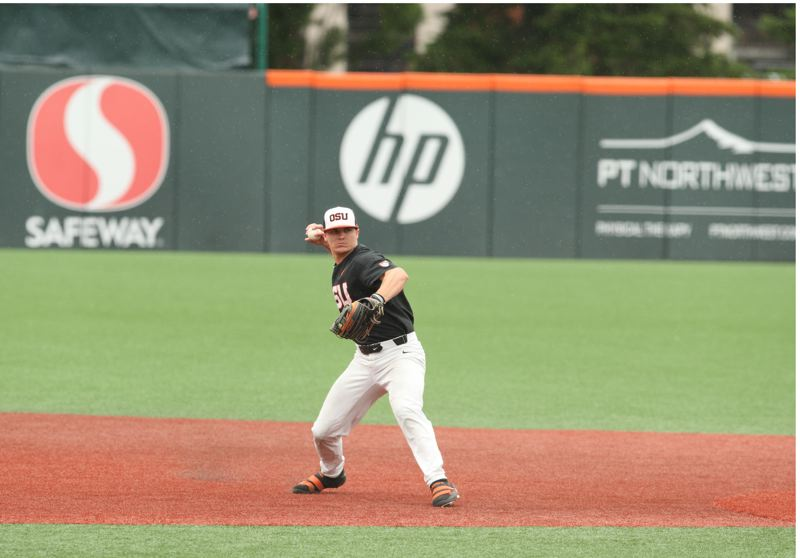 TRIBUNE PHOTO: SCOTT CASSIDY - OSU shortstop Cadyn Grenier throws out a runner at first base.