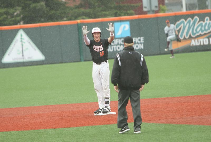 TRIBUNE PHOTO: SCOTT CASSIDY - Zak Taylor shows he's OK after hitting a double for Oregon State.