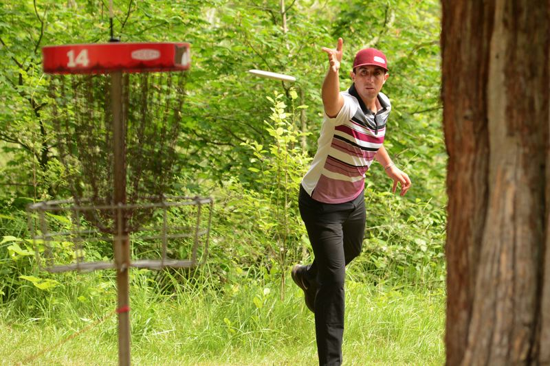 OUTLOOK PHOTO: DAVID BALL - Paul McBeth out of Huntington Beach, Calif., sends a putt toward the 14th cage.