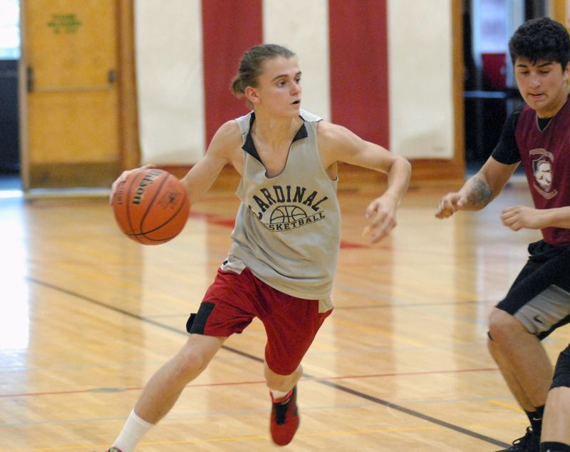 GRESHAM OUTLOOK: MATT RAWLINGS - Caden McCowen looks to beat his man off the dribble in Corbett's 50-40 loss to Sandy.