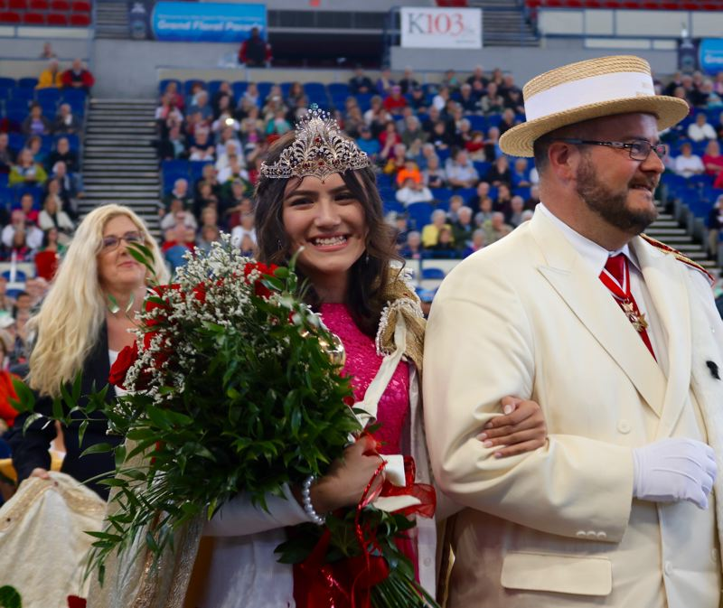 TRIBUNE PHOTO: ZANE SPARLING - Kiara Johnson of Parkrose High School smiles after being named the 2018 Queen of the Portland Rose Festival on Saturday, June 9 at the Veterans Memorial Coliseum.