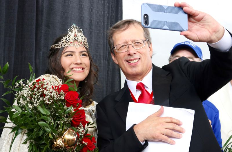 TRIBUNE PHOTO: ZANE SPARLING - A man takes a selfie with Rose Festival Queen Kiara Johnson on Saturday, June 9 in Portland.