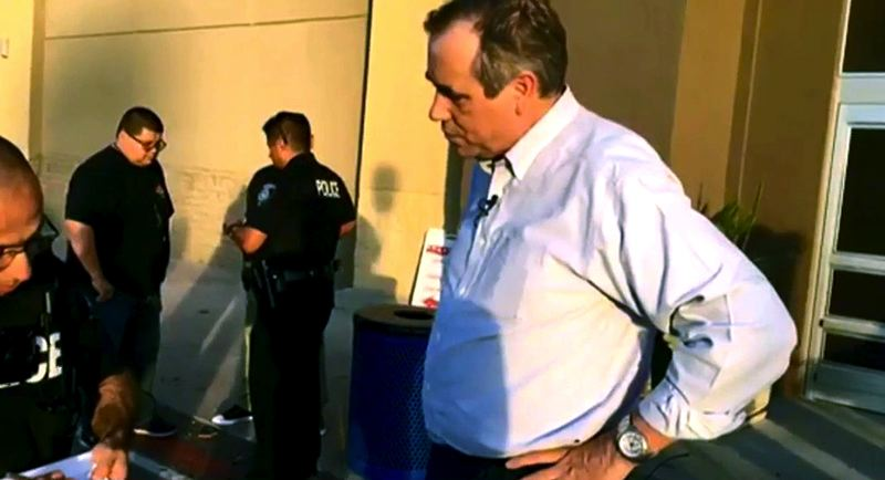 COURTESY PHOTO: FACEBOOK LIVE - Oregon U.S. Sen. Jeff Merkley talked with police officers outside a federal detention center in a converted Walmart store, during his attempt to visit a center where immigrant children are being held.