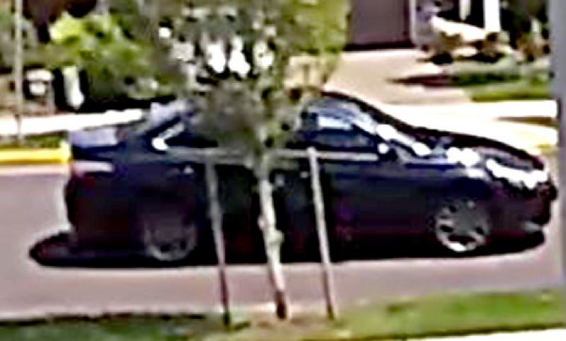 POLICE PHOTO - Police say the FedEx Faker is driving this 'newer' blue sedan, according to a news release.