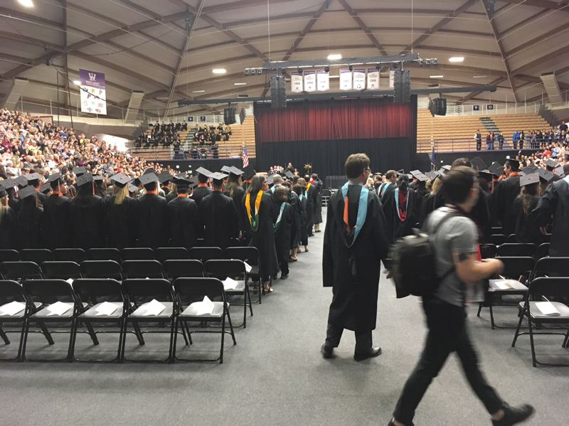PAMPLIN MEDIA GROUP: PETER WONG - The 420 graduates in Beaverton High School's Class of 2018 get ready to take their seats Friday, June 8, at the Chiles Center at the University of Portland.