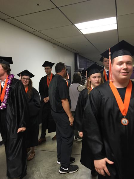 PAMPLIN MEDIA GROUP: PETER WONG - Brad Harvey, back to camera, is one of several Beaverton High Schoool staff members helping line up graduates on Friday, June 8, before they enter Chiles Center at the University of Portland. 'I know them all personally,' said Harvey, a security guard at the school for 23 years.