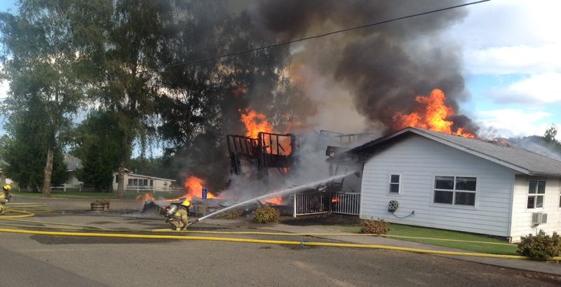 COURTESY PHOTO: FOREST GROVE FIRE & RESCUE - Firefighters hose down Hillside Bible Church near Forest Grove, which was badly damaged by fire on Saturday.