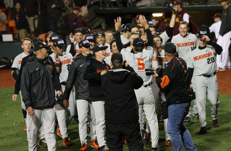 TRIBUNE PHOTO: SCOTT CASSIDY - Oregon State coach Pat Casey greets the players after their victory lap around Goss Stadium on Saturday night.