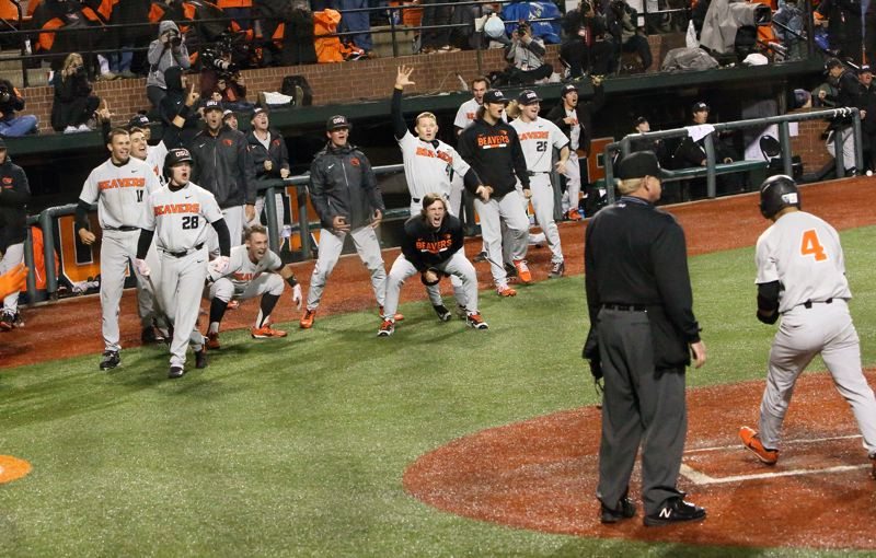 TRIBUNE PHOTO: SCOTT CASSIDY - The Oregon State Beavers welcome Steven Kwan after he scored the go-ahead run in the ninth inning on Saturday night at Goss Stadium, where OSU rallied to beat Minnesota, 6-3, and advance to the College World Series.