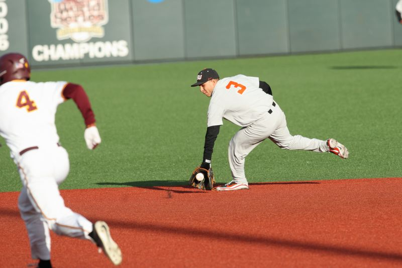 TRIBUNE PHOTO: SCOTT CASSIDY - Second baseman Nick Madrigal of Oregon State snares a ground ball early in the game.