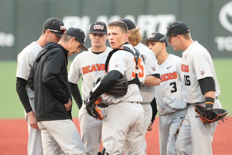 TRIBUNE PHOTO: SCOTT CASSIDY - Coach Pat Casey, catcher Adley Rutschman and the Oregon State infield meet with starting pitcher Bryce Fehmel on the mound during a rough stretch early in the game.