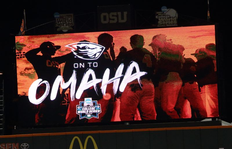 TRIBUNE PHOTO: SCOTT CASSIDY - The scoreboard at Goss Stadium tells the story: No. 3 seed Oregon State is on its way to Omaha, Nebraska, for the College World Series.