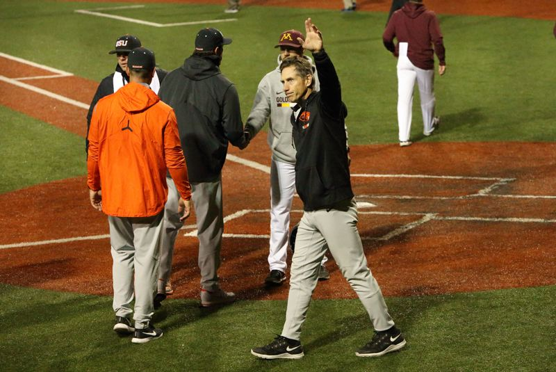 TRIBUNE PHOTO: SCOTT CASSIDY - After a long, tension-filled night and battle to the end with 14th-seeded Minnesota, Oregon State coach Pat Casey waves to members of the record crowd (4,025) at Goss Stadium.