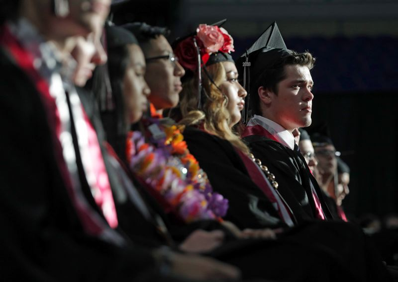 TIMES PHOTO: JONATHAN HOUSE - Tualatin graduates listen to speakers during their commencement at Memorial Coliseum.