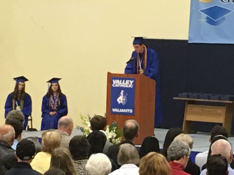 PAMPLIN MEDIA GROUP: PETER WONG - Matthew Ierardi, one of three valedictorians in the Class of 2018, speaks Saturday, June 9, at the commencement ceremony in the gym at Valley Catholic High School in Beaverton. Others to left are Dana Taylor and Rosie Parker.