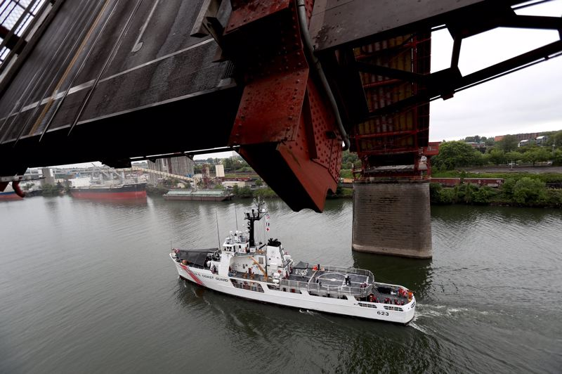 PAMPLIN MEDIA GROUP: JAIME VALDEZ - A U.S. Coast Guard vessel sailes under the Steel Bridge as it steams out of Portland, marking the end of the Rose Festival's Fleet Week.