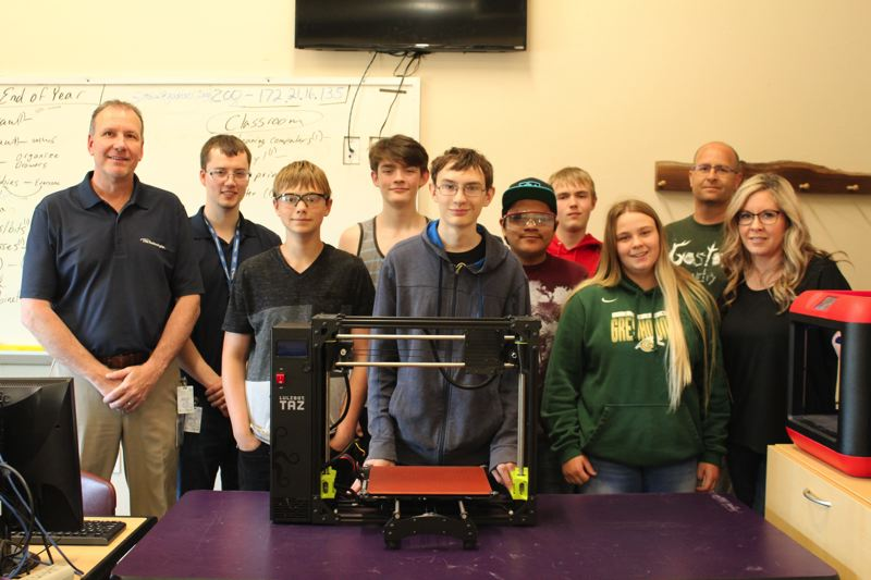 STAFF PHOTO: OLIVIA SINGER - TTM representatives presented the 3D printer to students and their teacher at Gaston High School on Tuesday, June 5.