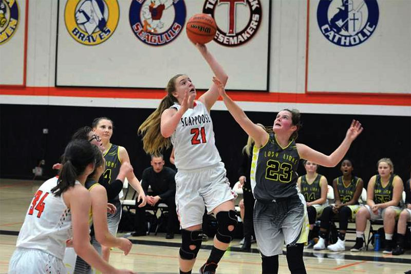 SPOTLIGHT FILE PHOTO - Scappoose's Kaylee Wegner had many highlights with the Indians this year, including this one — helping the Indians beat her former team in the annual Seven-Mile War.