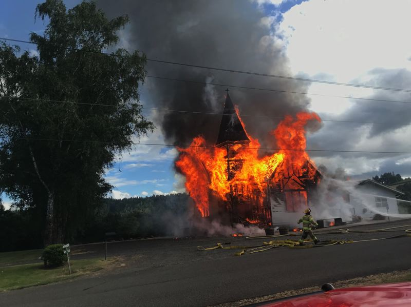 COURTESY PHOTO: FOREST GROVE FIRE & RESCUE - Flames consume the Hillside Bible Church building outside Forest Grove on Saturday evening. A fire investigation reportedly concluded the fire was caused by an electrical issue under the church's main floor.