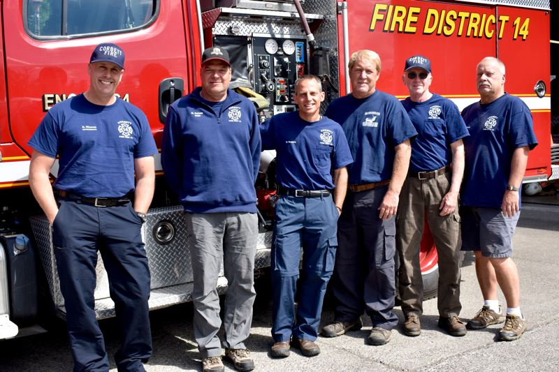 OUTLOOK PHOTO: MATT DEBOW - Volunteer Corbett firefighters on Monday, June 4, pose with the fire engine that was used during the Eagle Creek Fire. From left, Rick Wunsch, Nelson Rolens, Vance Rogers, Larry Traxler, Daren Martin and Brad Loitved.