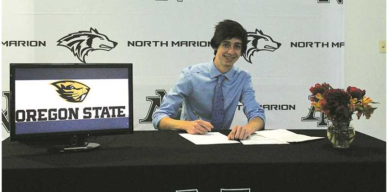 LINDSAY KEEFER - Logan Gianella sings his letter of intent for the music program at Oregon State University.