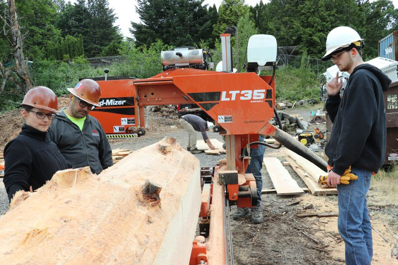 CONTRIBUTED PHOTO: MT. HOOD COMMUNITY COLLEGE - Natural resources technology students at Mt. Hood Community College work with the colleges new portable sawmill.